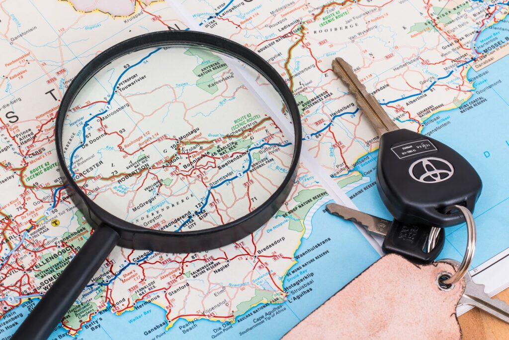 map with keys and magnifying glass