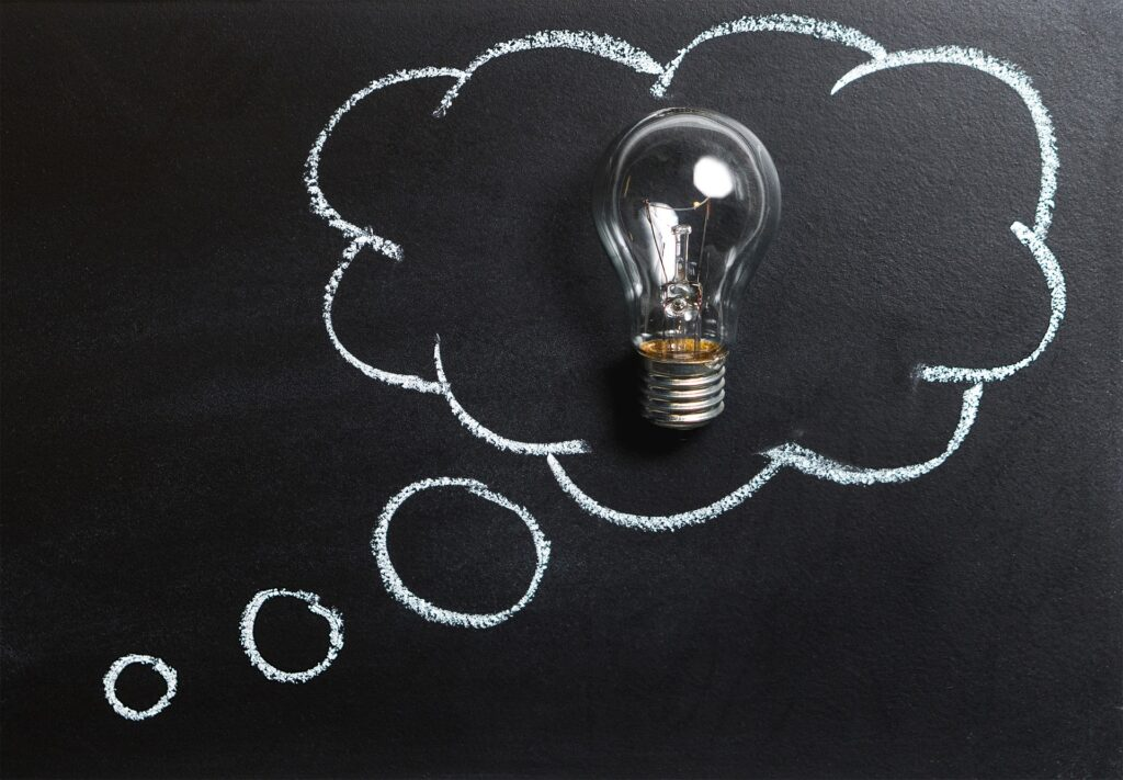 lightbulb with chalk thought bubble