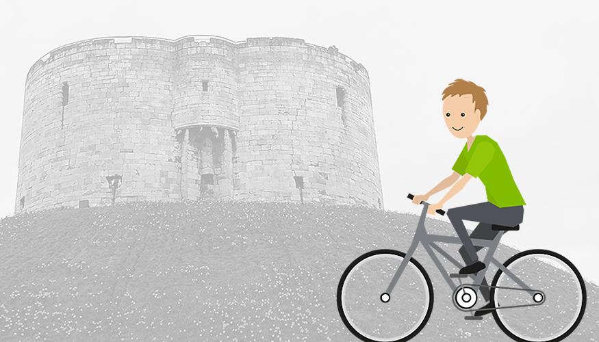 Quantum bike passing Cliffords tower York