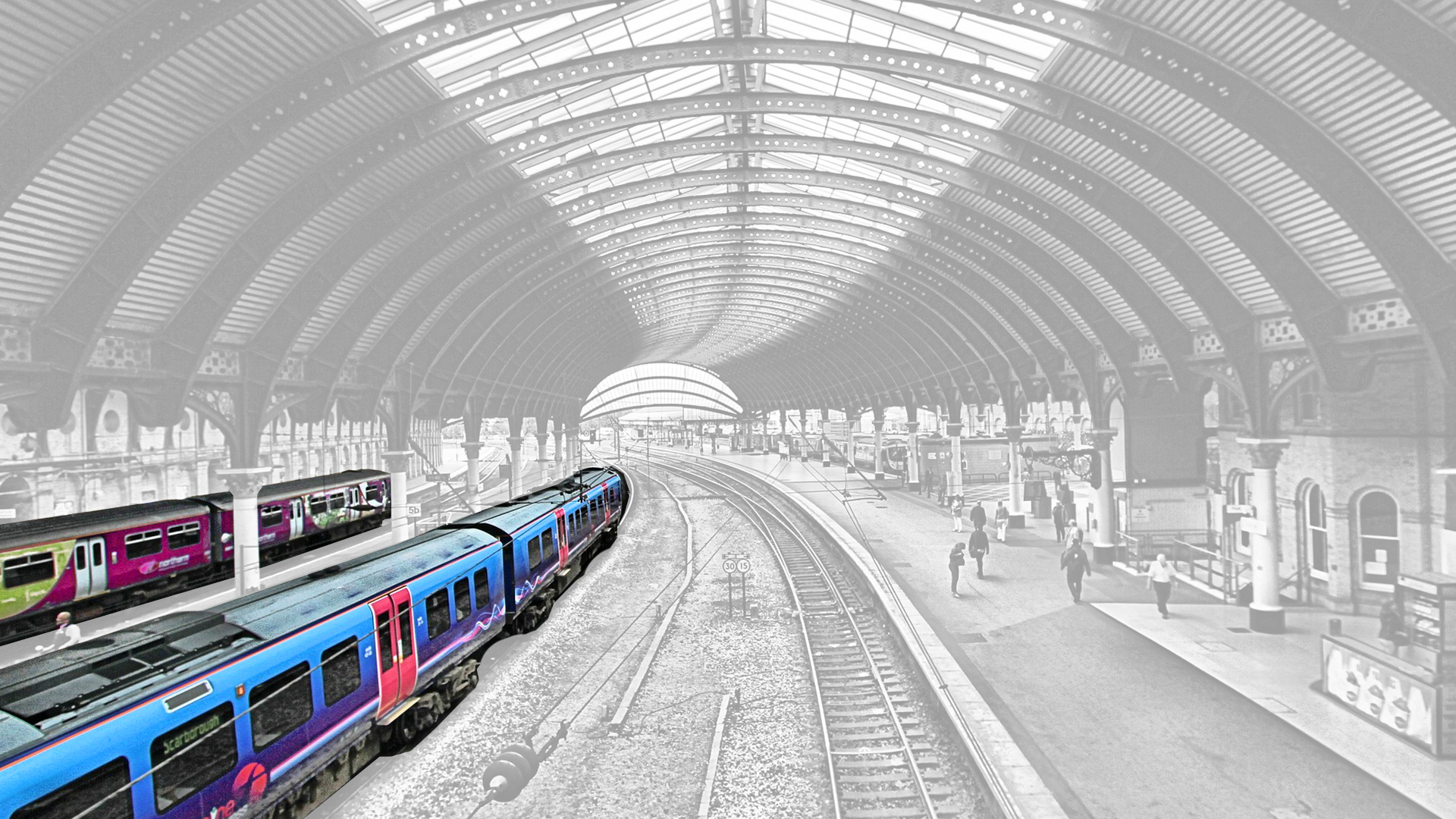 York station black and white with colourful train