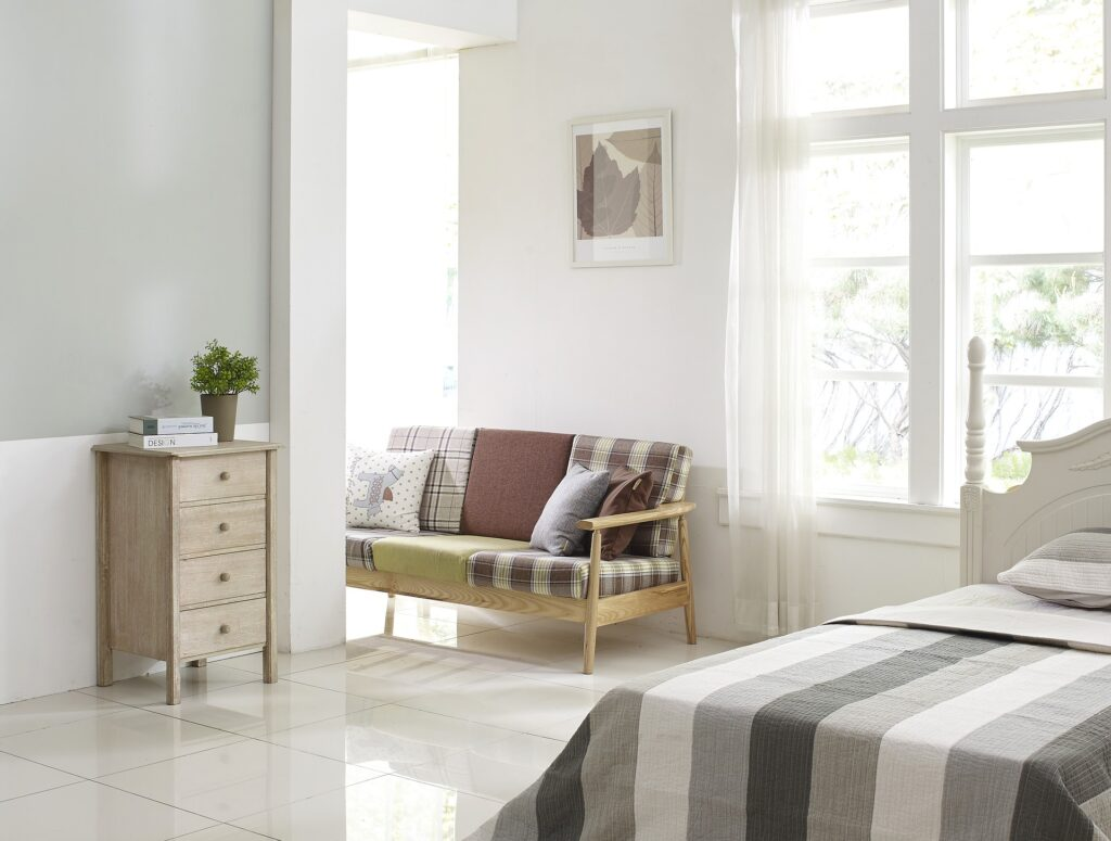 room with bed, sofa and chest of drawers