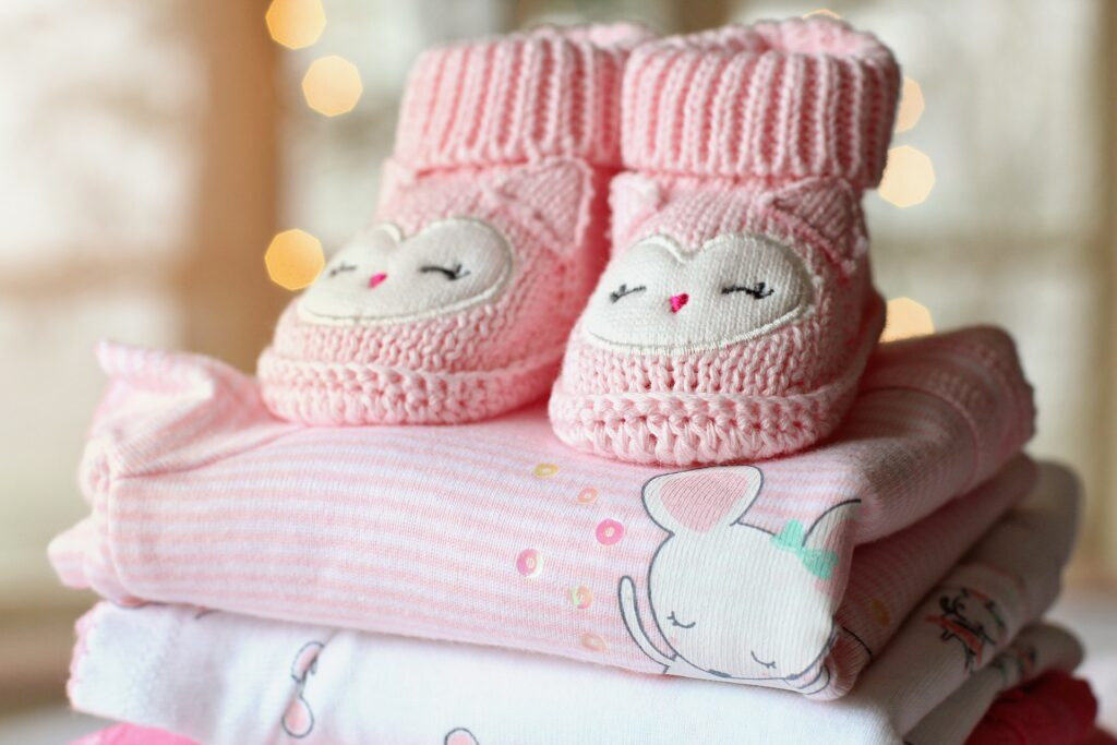 baby clothes in a pile