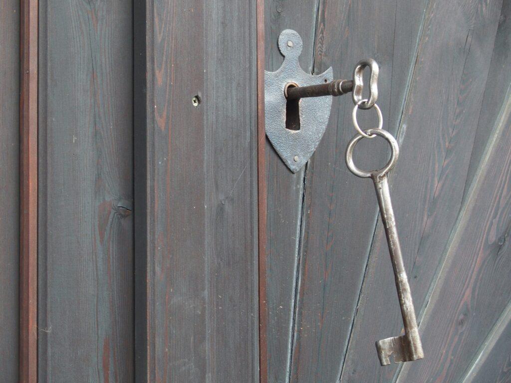 key in lock on wooden gate