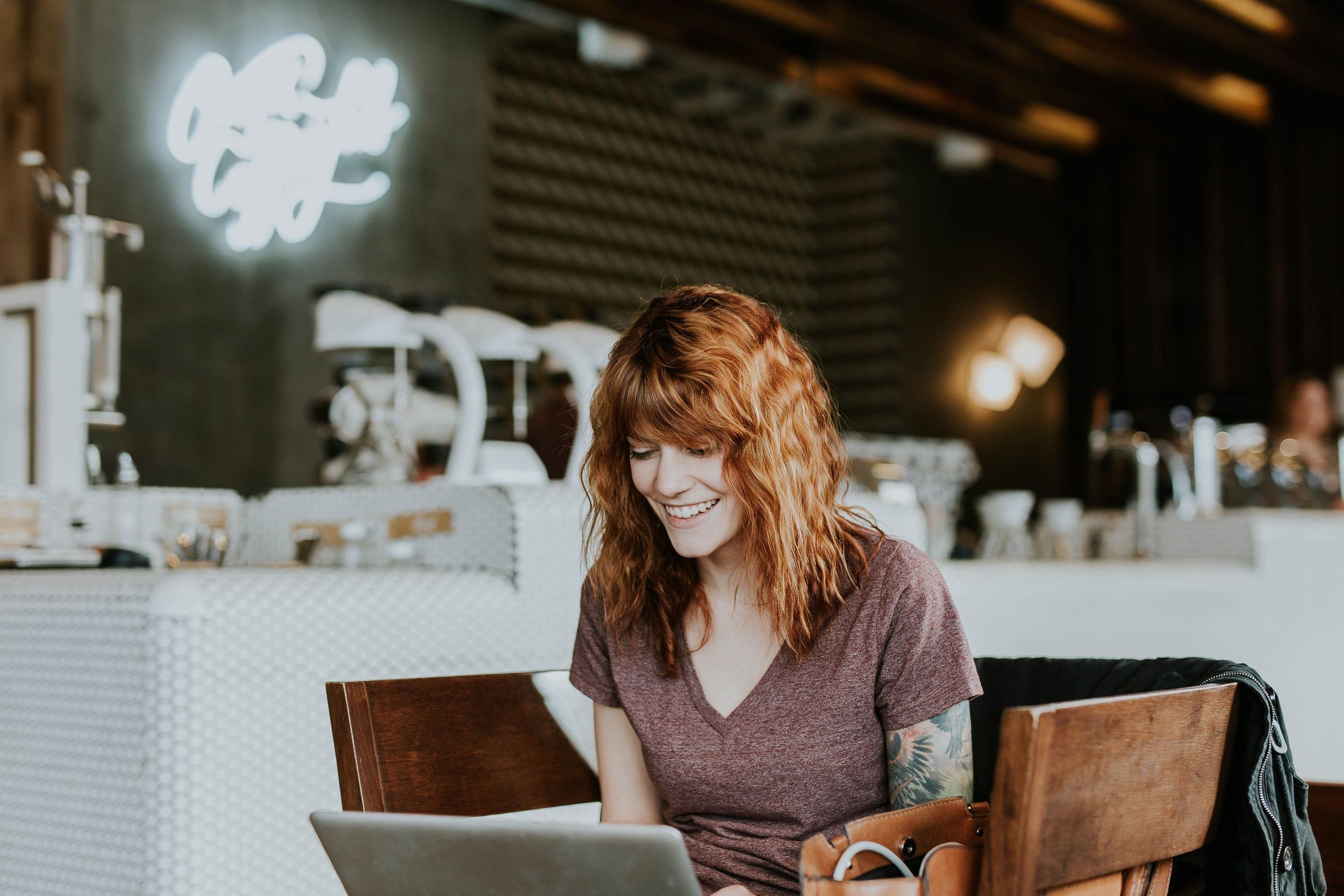 business woman in cafe Photo by Brooke Cagle on Unsplash