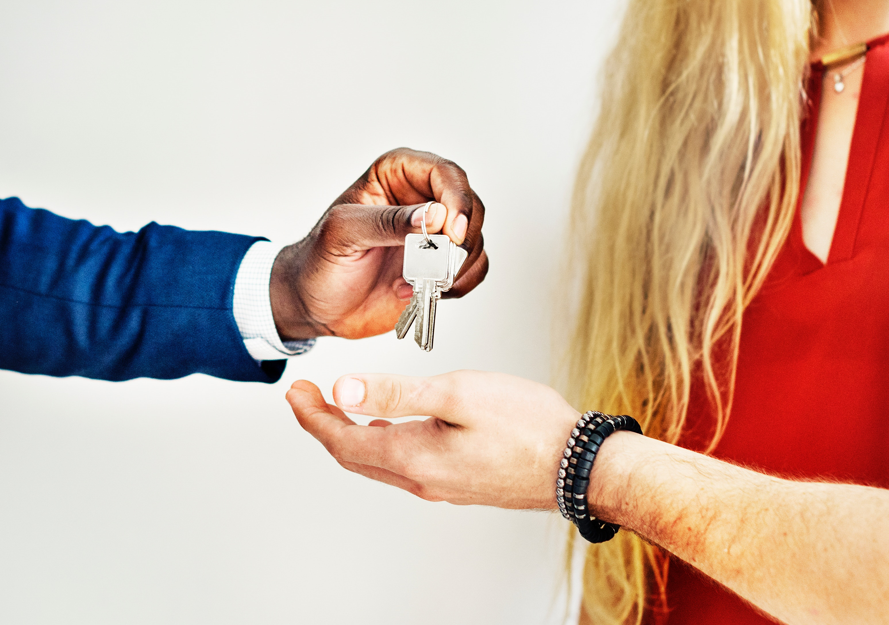 Person handing keys over Photo by rawpixel on Unsplash