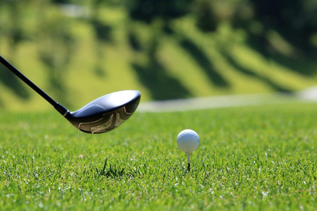 golf club next to golf ball