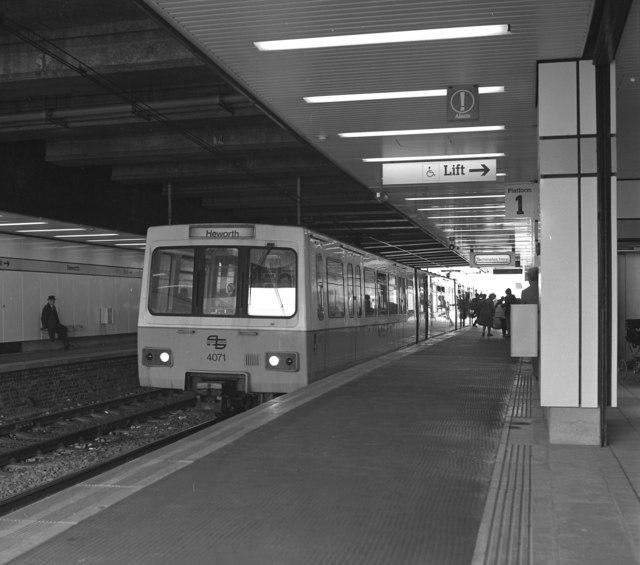 train station with train at platform