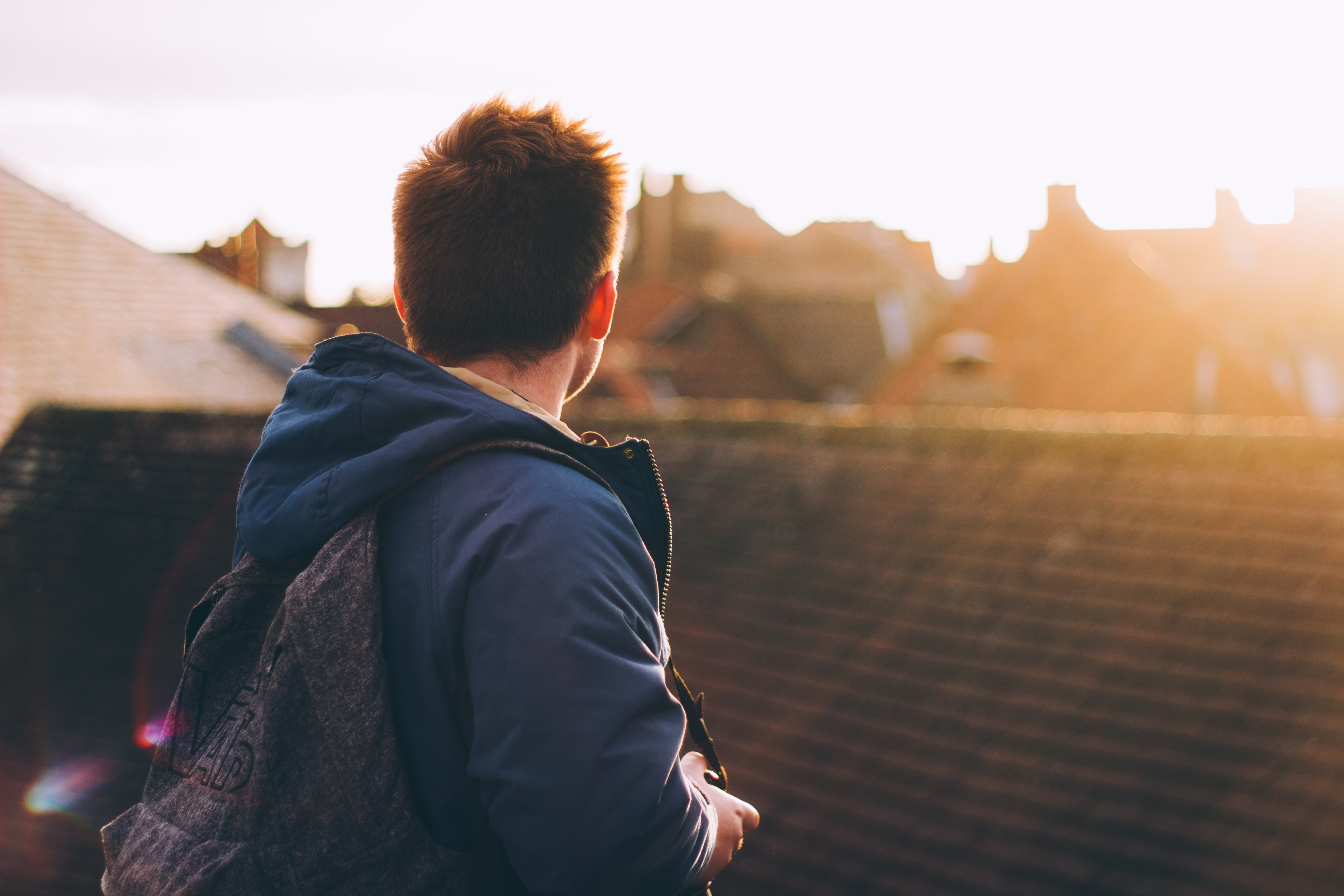 Man looking across York rooftops