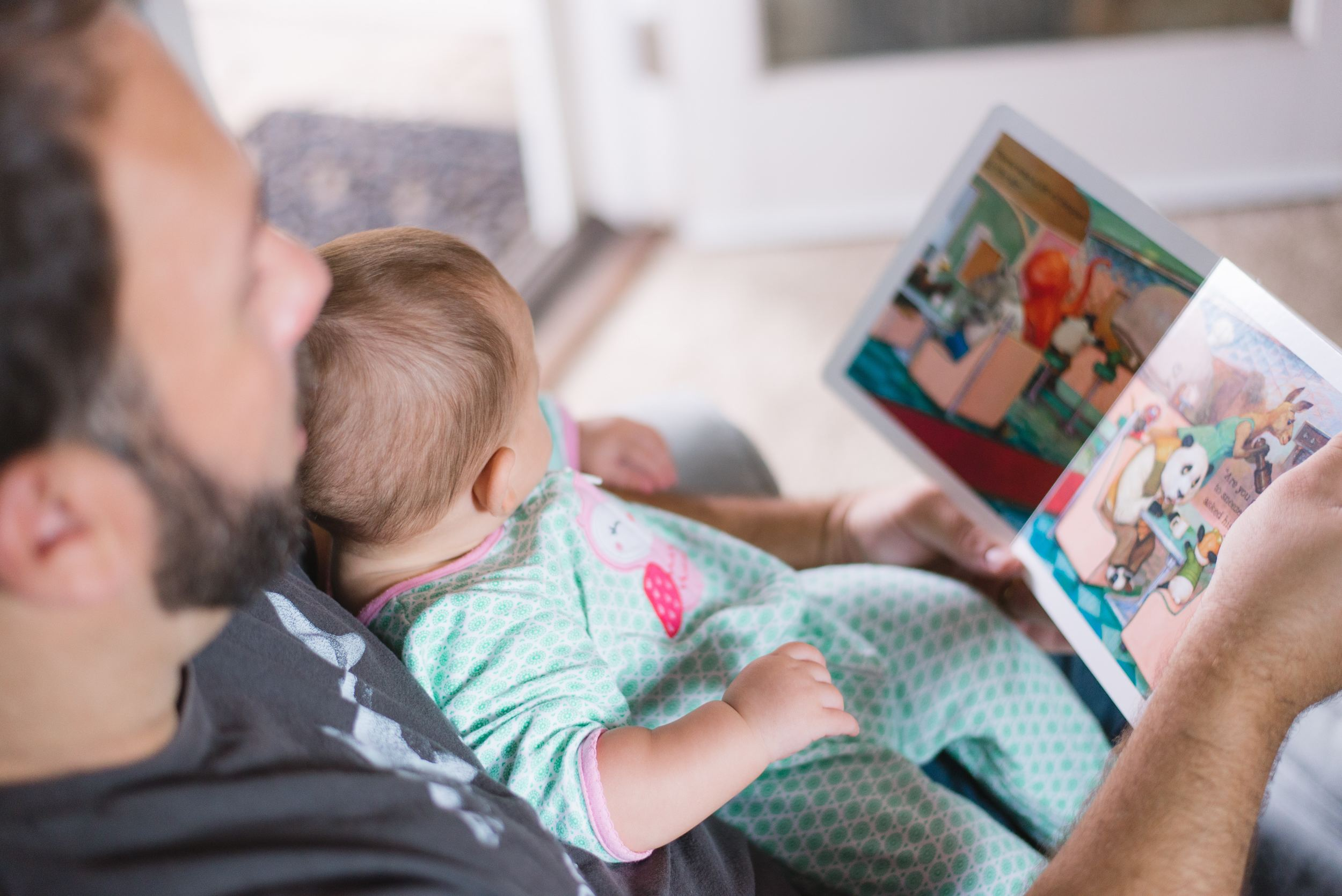 father with child reading a book