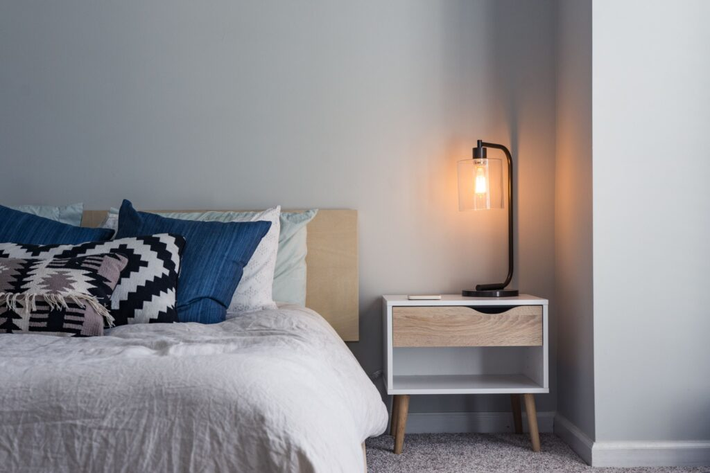 double bed next to lamp on bedside table