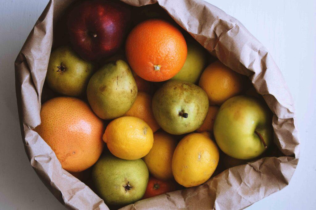 pile of fruit in paper bag