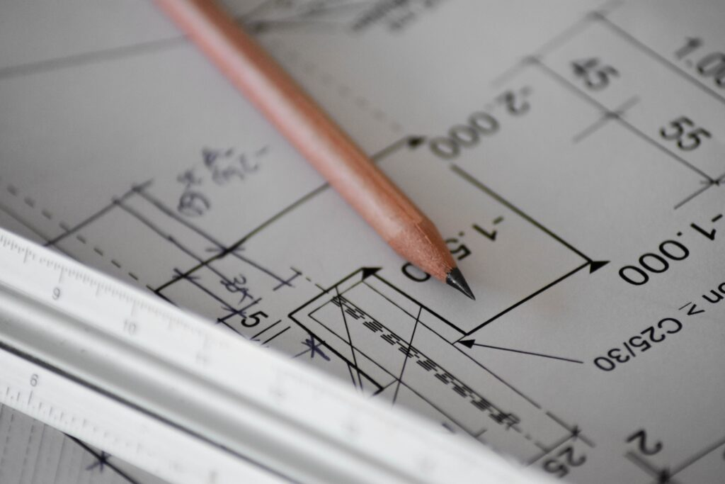 pencil and ruler resting on blueprints