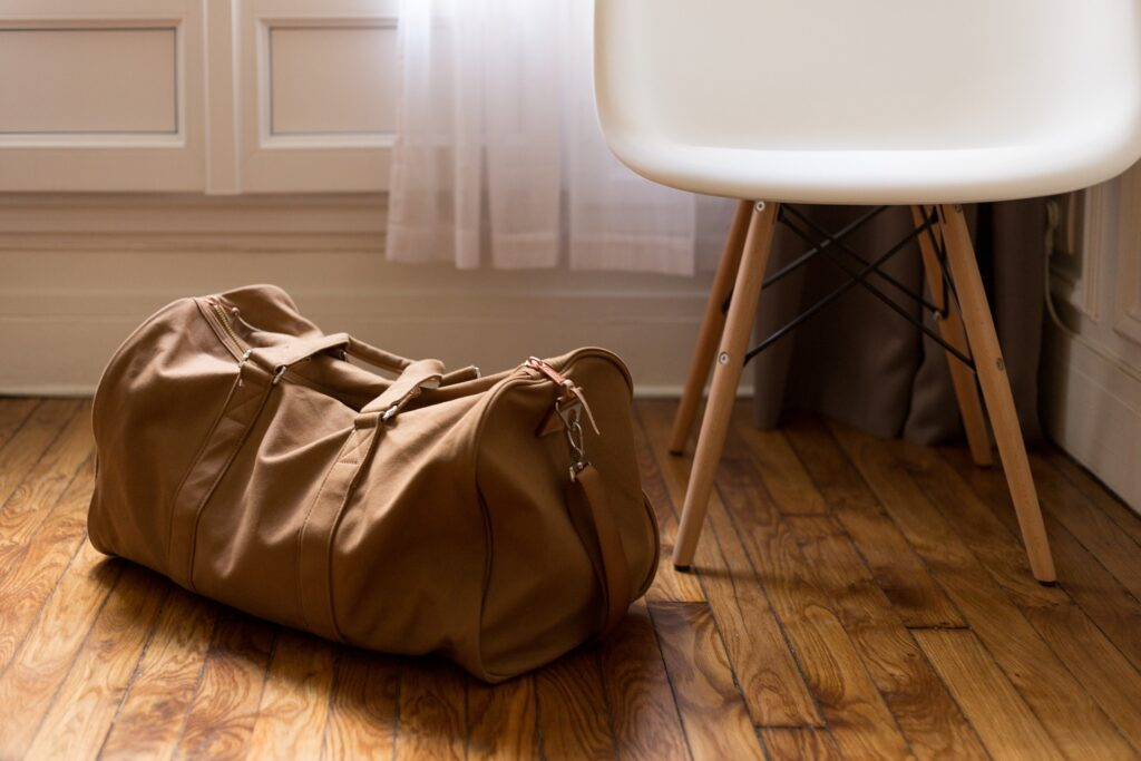 duffel bag next to chair