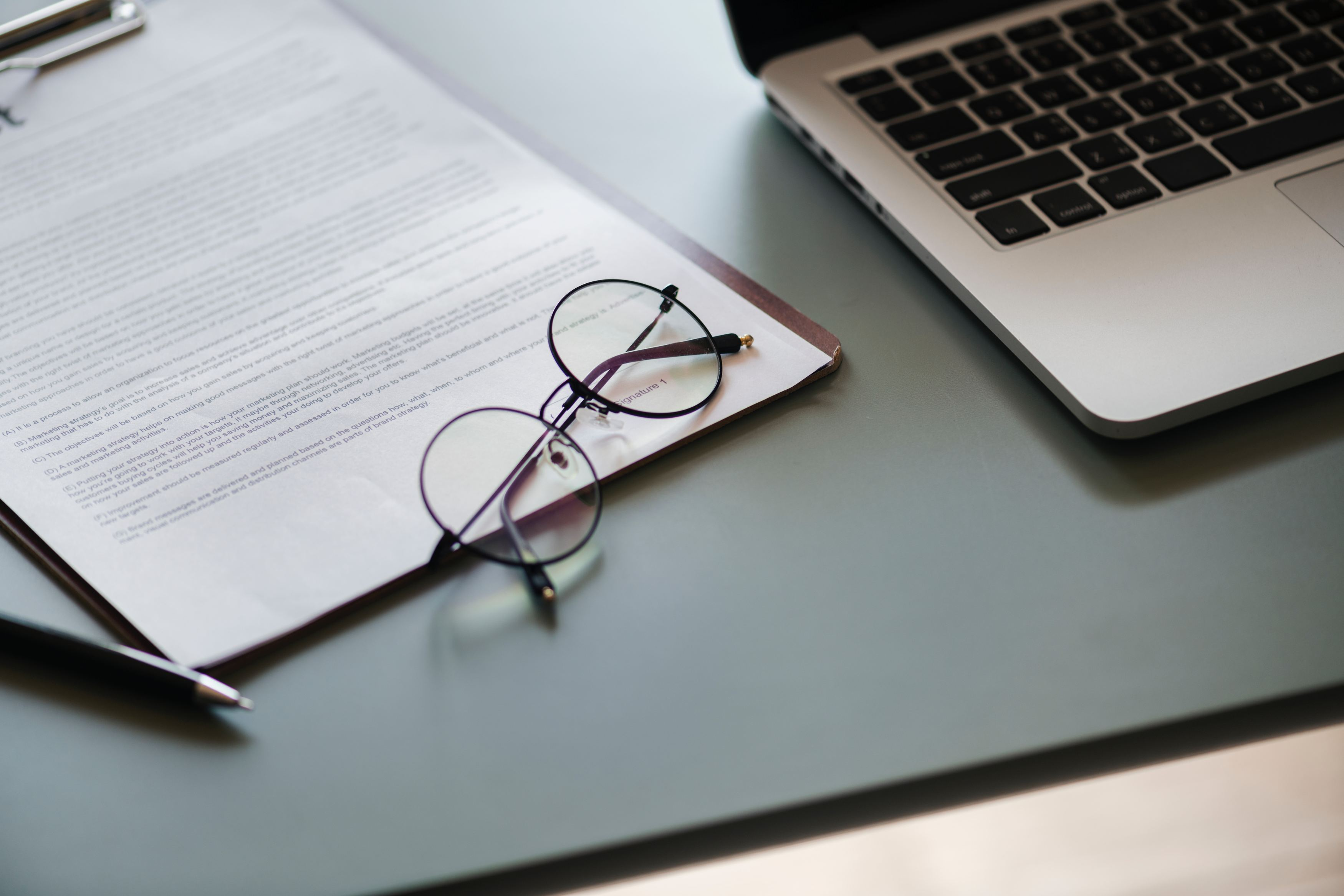 contract with glasses and laptop Photo by rawpixel on Unsplash