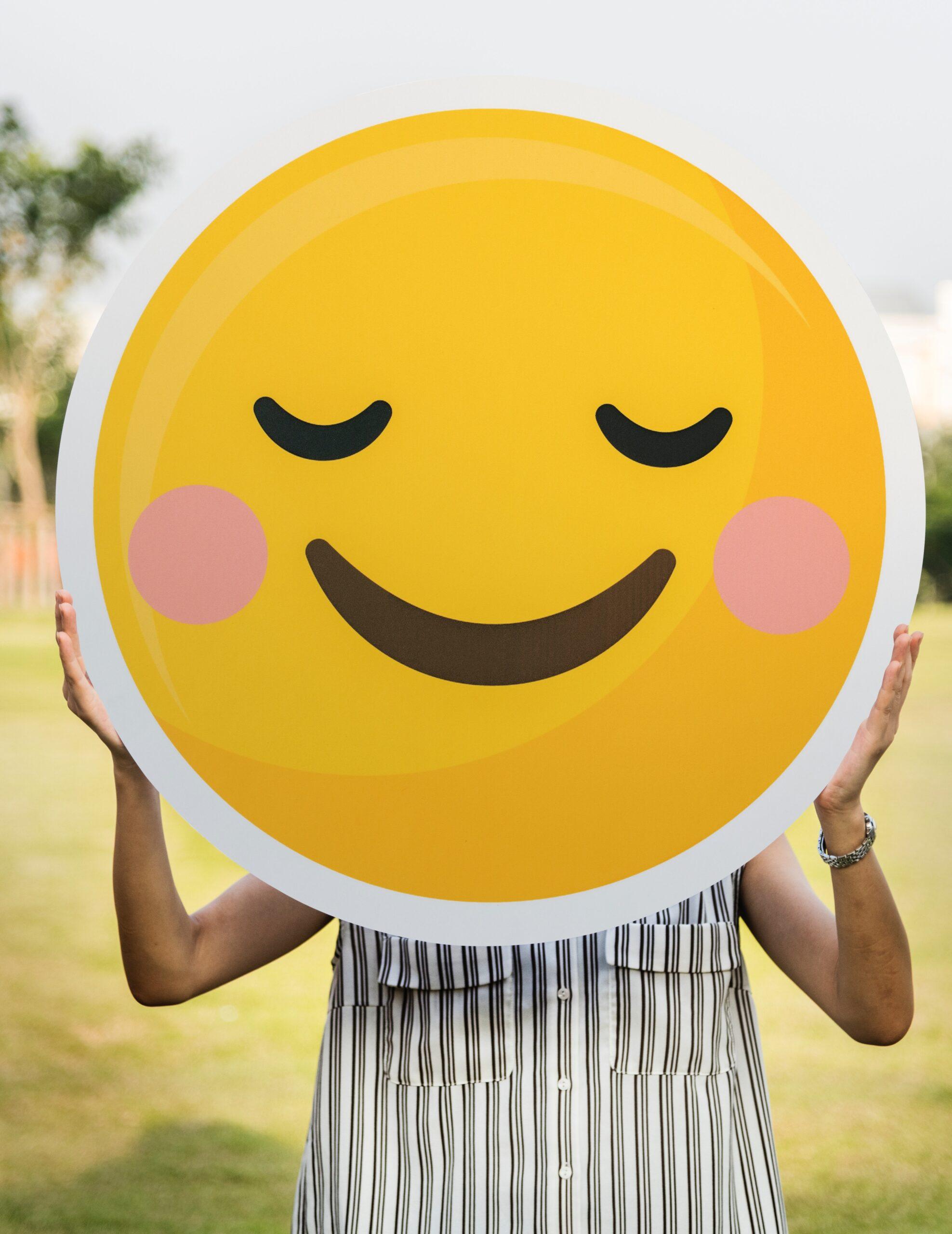 person holding up happy emoji
